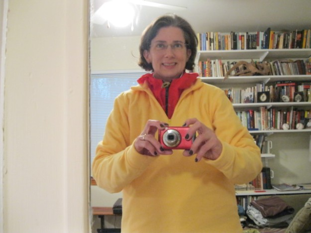 Amy in a garish yellow fleece over a bright red windbreaker.
