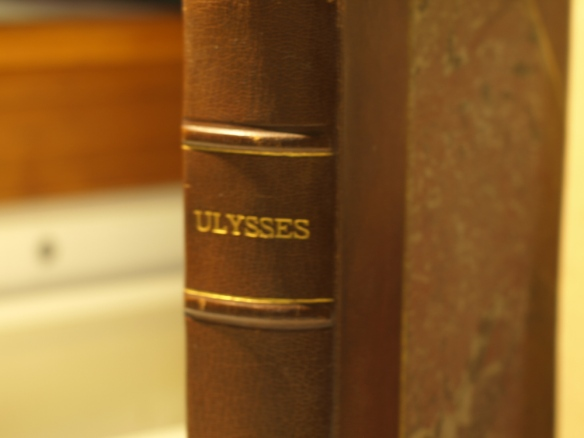 Shows spine of weathered copy of Ulysses