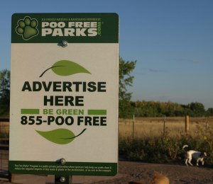 "Sign that reads ""Poo Free Parks""  Advertise Here.  Be Green.  855-POO-FREE."