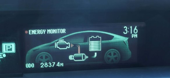 "{Image:  photo of a diagram of a car showing three unnamed parts with arrows going from one to another.  The diagram is labeled ""Energy Monitor.""  The display also contains the time (3:16 PM) and  the odometer (2837.4 MI).}"