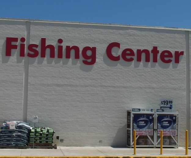"{Image:  Exterior of a large brick building with red letters that read ""Fishing Center.""}"