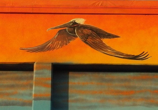 Image:  mural painting of pelican in flight.