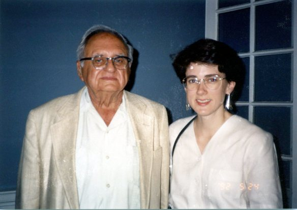 Image: photo of an older white many in a linen jacket and open colar white shirt and a white woman in her 30s with short dark hair also wearing a linen shirt.