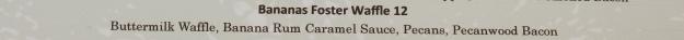 "Image: cropped photo of menu item: ""Bananas Foster Waffle: Buttermilk Waffle, Banana Rum Caramel Sauce, Pecans, Pecanwood Bacon"""