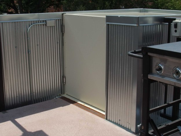 Image: photo of the door to an open-air wheelchair lift.