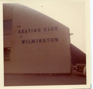 "Image:  The side of a building, painted white, with large letters spelling out ""Skating Club of Wilmington."""