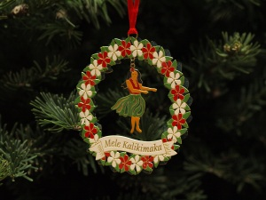 Image: Hawaiian dancer ornament with text Mele Kalikimaka