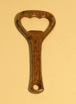 Image: weathered bottle opener.