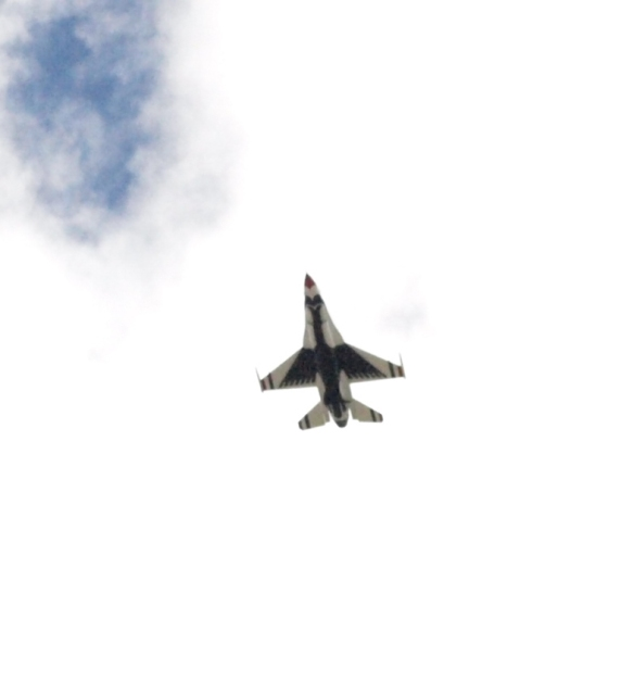 Image: zoomed in photo of underside of fighter jet.