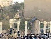 Image:  Wide angle shot of Baghdad square as the statue of Saddam is pulled down.