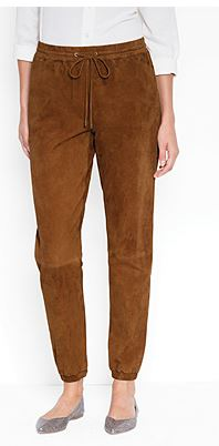 """Image: What more do I need to say than """"goat suede track pants."""" They are rust brown, made of goat skin, and shapelessly elasticized."""